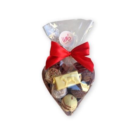 Mittelgroßes Schokoladenherz aus Vollmilch, mit Pralinen befüllt