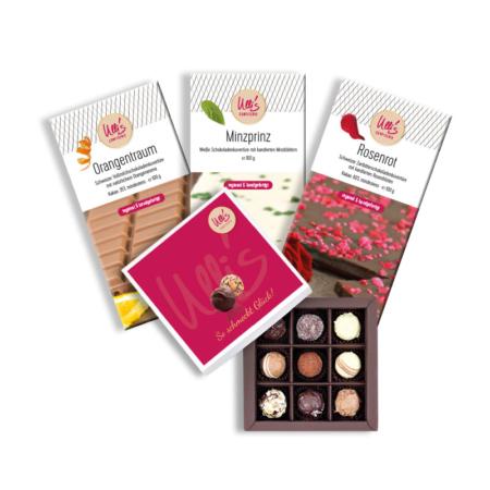 Probierpaket mit Pralinenschachtel und drei Schokoladentafel